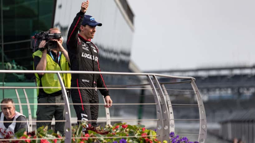 Robert Wickens gives a thumbs up to the crowd in victory circle at Indianapolis Motor Speedway