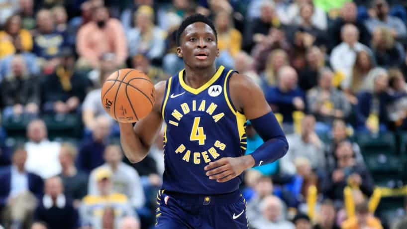 Pacers guard Victor Oladipo brings up the ball in a game.
