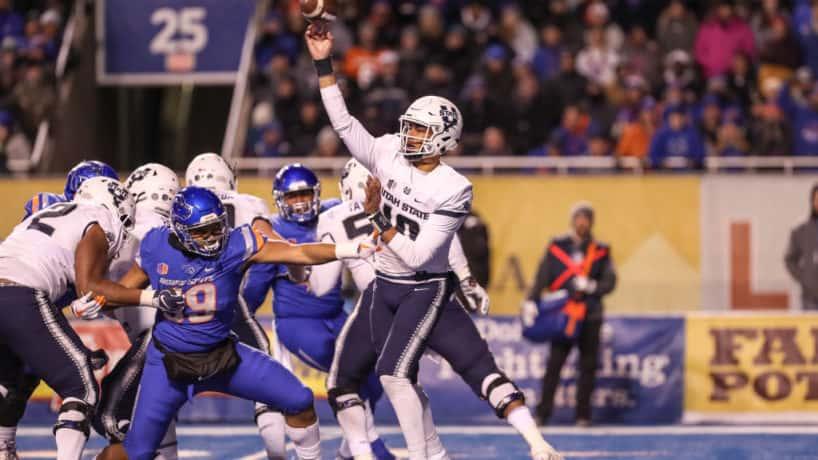 Jordan Love pressured by Boise State defensive lineman