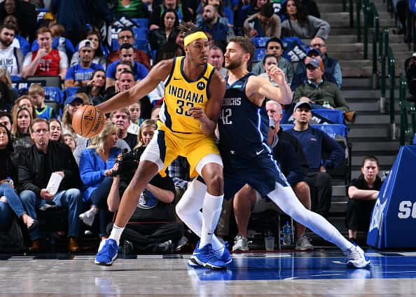 Pacers center Myles Turner dribbles in the post against Dallas.