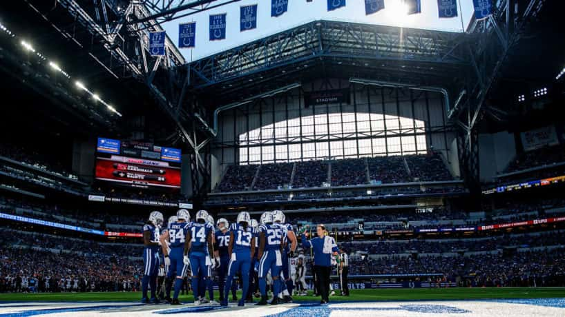 The Colts gather in the huddle before a play at Lucas Oil Stadium.