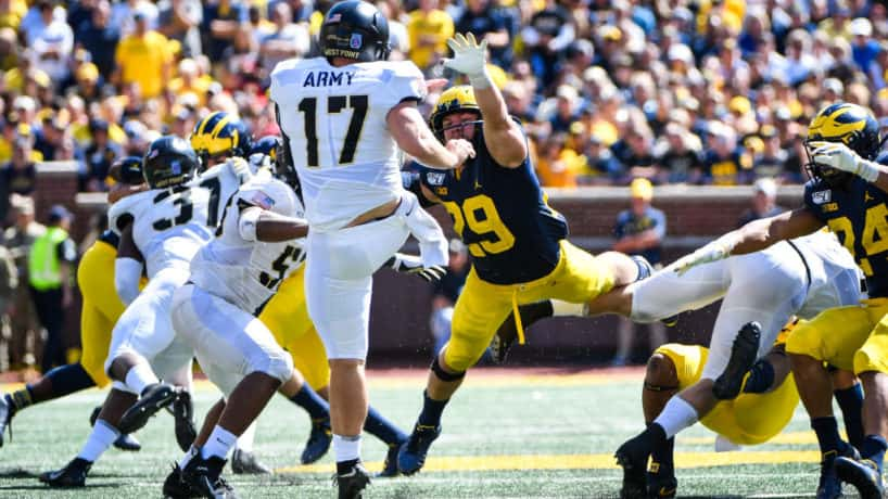 Michigan special teamer Jordan Glasgow lays out to block a punt.