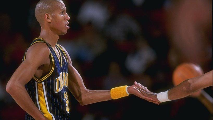 Reggie Miller high fives Pacers teammate