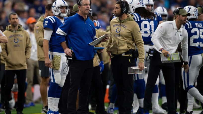 Colts offensive coordinator Nick Sirianni talks to Frank Reich during a game.
