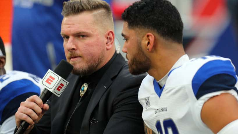 Pat McAfee interviewing quarterback Jordan Ta'amu on bench