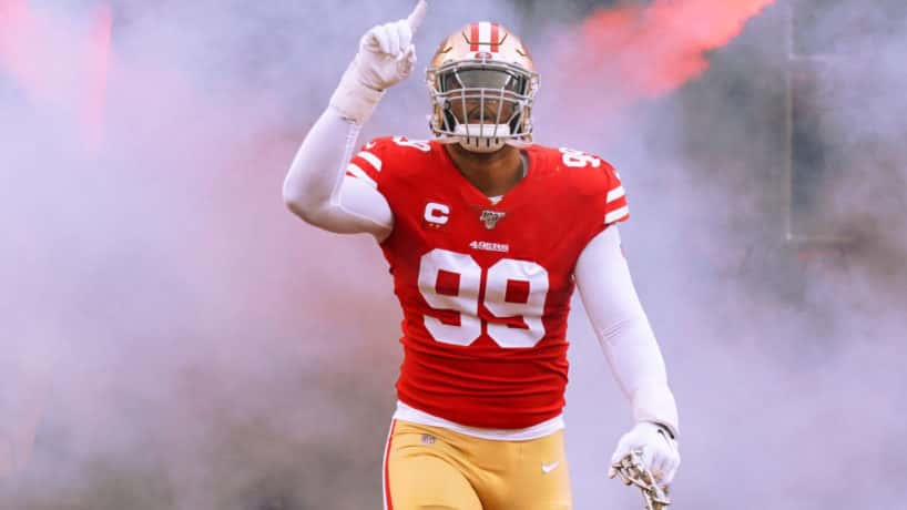 49ers defensive end DeForest Buckner runs out of the tunnel in 2019.