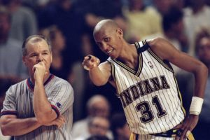 Reggie Miller #31 of the Indiana Pacers gestures as referee Jerry Crawford looks on during an Eastern Conference Final game against the Chicago Bulls at the Market Square Arena in Indianapolis, Indiana.