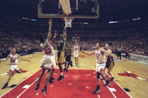 Travis Best #4 of the Indiana Pacers shoots over Scottie Pippen #33 of the Chicago Bulls during an Eastern Conference Final game at the United Center in Chicago, Illinois.