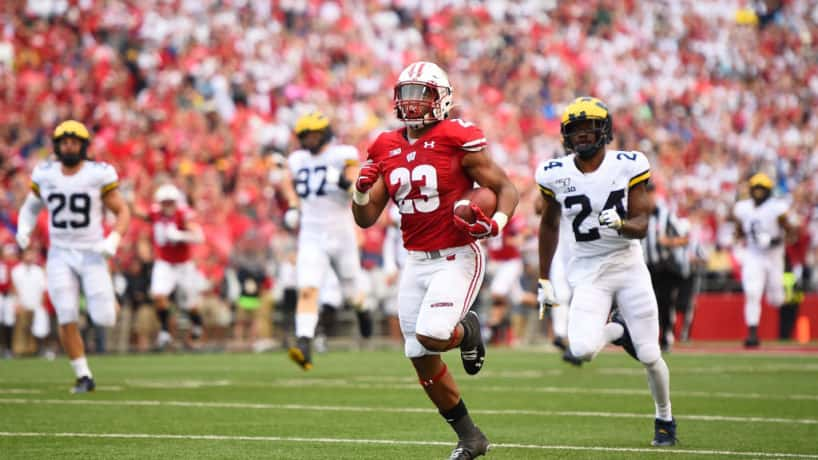 Wisconsin running back Jonathan Taylor runs in the open field.