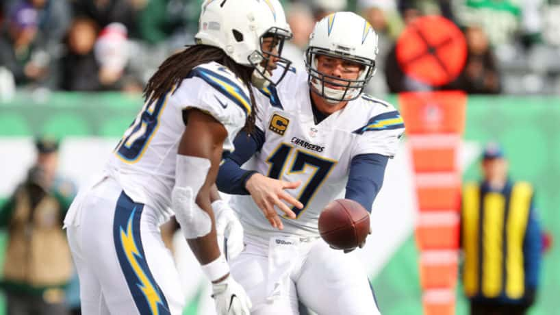Philip Rivers hands off the ball in a game with the Chargers.