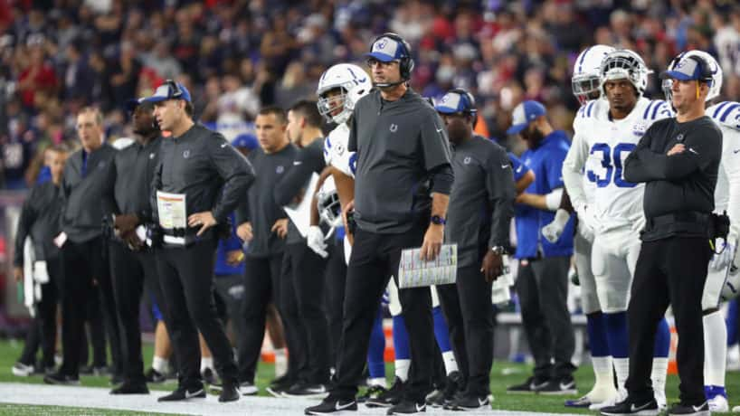 Colts head coach Frank Reich looks on, with his assistants, from the sideline.
