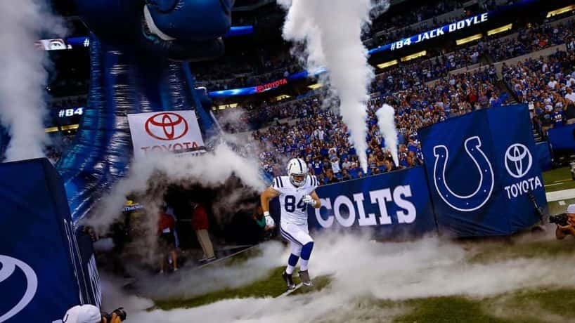 Colts tight end Jack Doyle runs out of the tunnel.