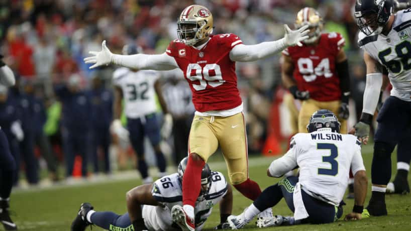 49ers defensive lineman DeForest Buckner reacts after a sack.