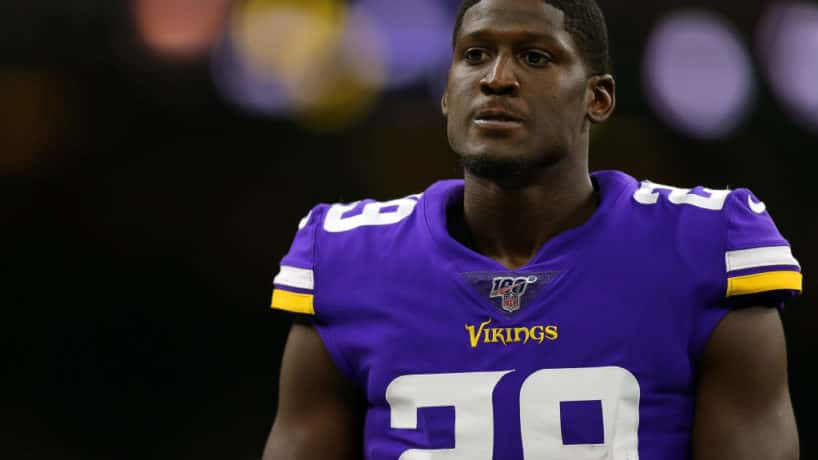 Former Vikings cornerback Xavier Rhodes looks on before a 2019 game.