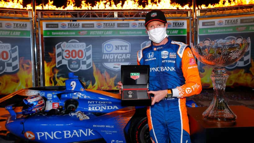 Scott Dixon, driver of the #9 PNC Bank Chip Ganassi Racing Honda, celebrates in Victory Lane after winning the NTT IndyCar Series - Genesys 300 at Texas Motor Speedway