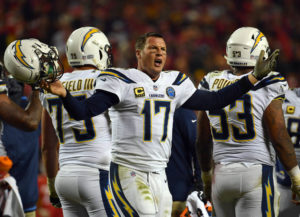 Quarterback Philip Rivers #17 of the Los Angeles Chargers protests a non-call after being hit in the helmet during the game against the Kansas City Chiefs at Arrowhead Stadium