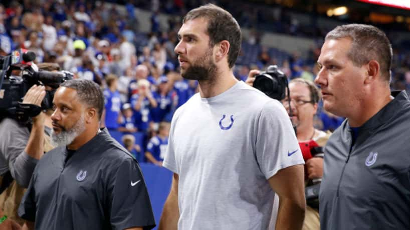 Andrew Luck #12 of the Indianapolis Colts walks off the field after a report of his retirement after the Indianapolis Colts preseason game against the Chicago Bears at Lucas Oil Stadium on August 24, 2019 in Indianapolis, Indiana