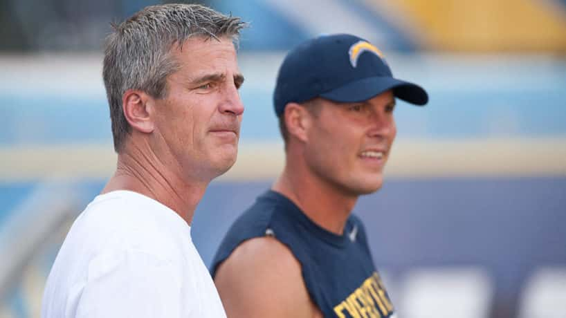 Frank Reich and Philip Rivers talk before a 2014 game.