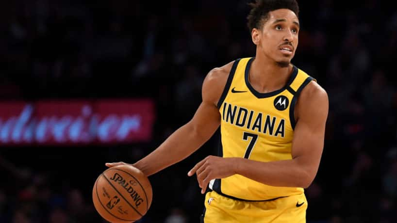 Pacers guard Malcolm Brogdon dribbles in a road game.