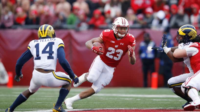 Wisconsin running back Jonathan Taylor runs against Michigan.