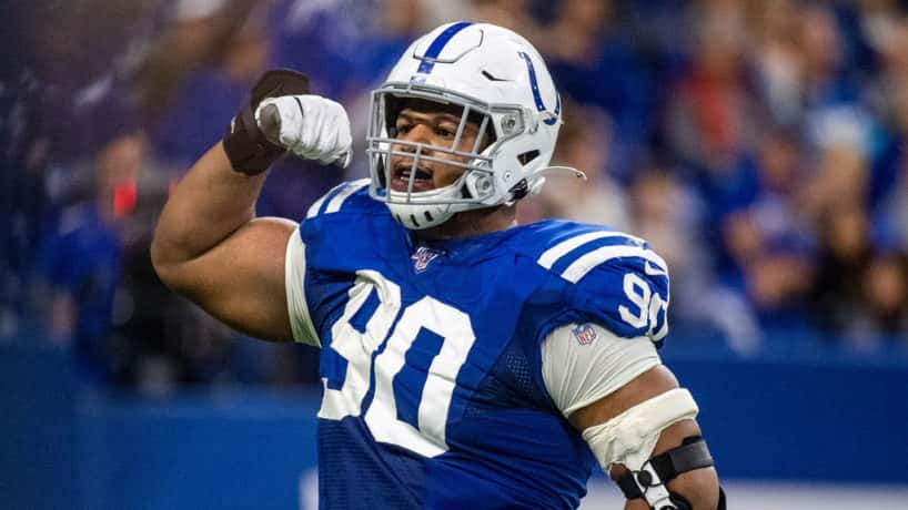 Colts defensive tackle Grover Stewart flexes after a big play.