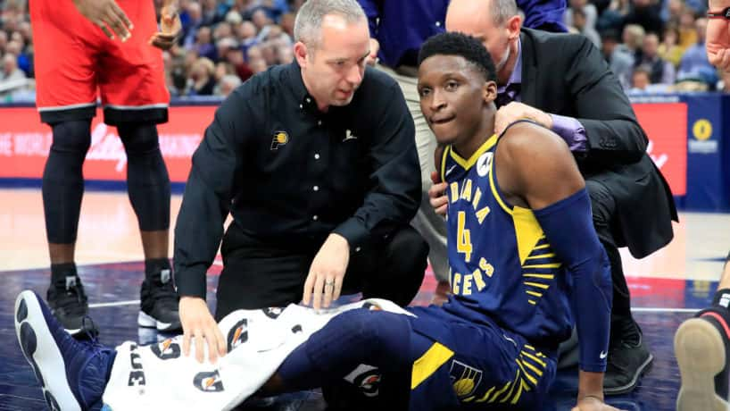 Pacers guard Victor Oladipo sits on the floor hurt.
