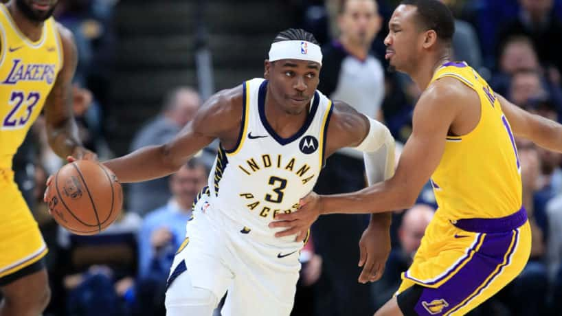 Pacers guard Aaron Holiday dribbles in a 2019 game.