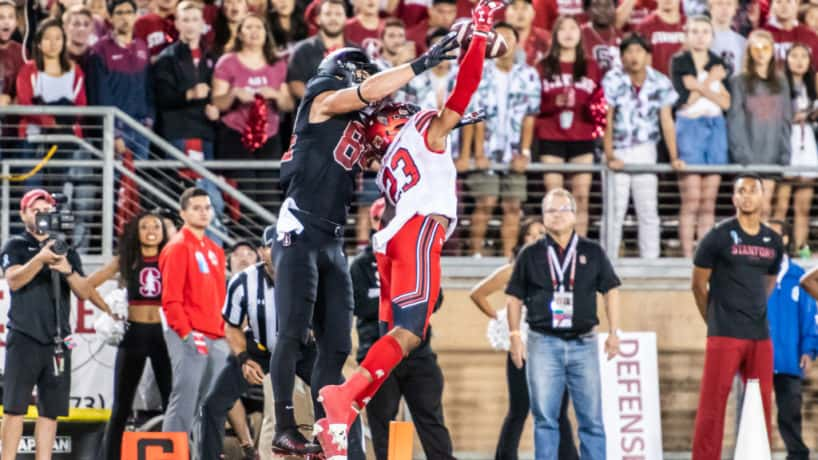 Former Utah safety Julian Blackmon knocks down a pass in a 2019 game.