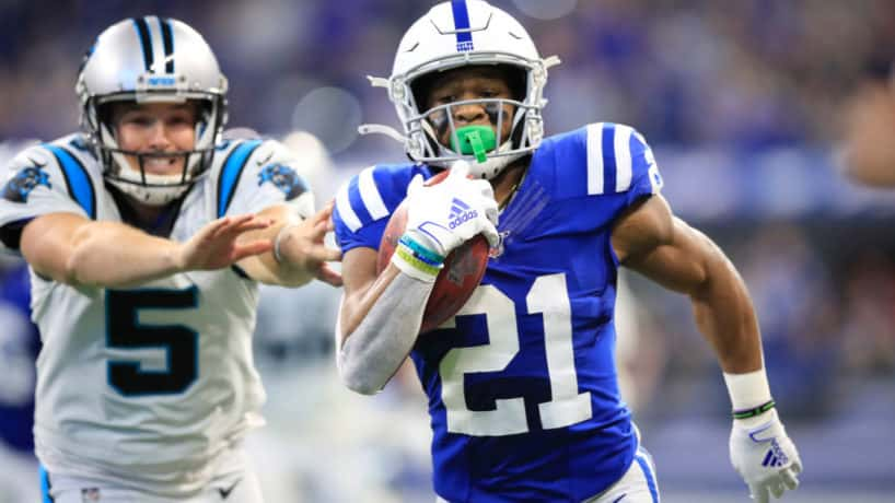 Colts kick returner Nyheim Hines returns a punt for a touchdown against Carolina in 2019.