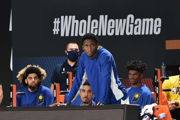 Pacers guard Victor Oladipo watches from the bench in the Pacers re-start.
