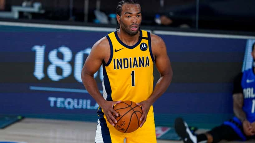Pacers forward T.J. Warren looks to pass in a bubble game in Orlando.