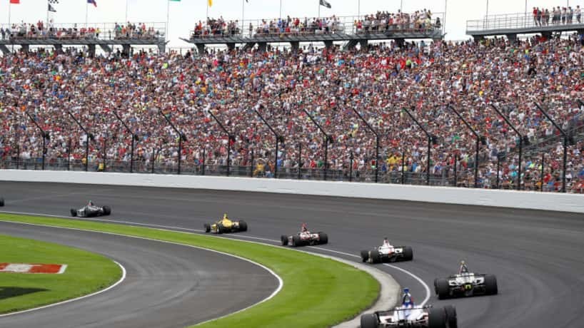 The field takes the turn one after the restart during the 103rd Indianapolis 500 at Indianapolis Motor Speedway on May 26, 2019 in Indianapolis, Indiana