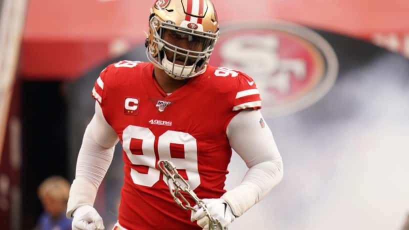 Former 49ers defensive tackle DeForest Buckner runs out of the tunnel in 2019.