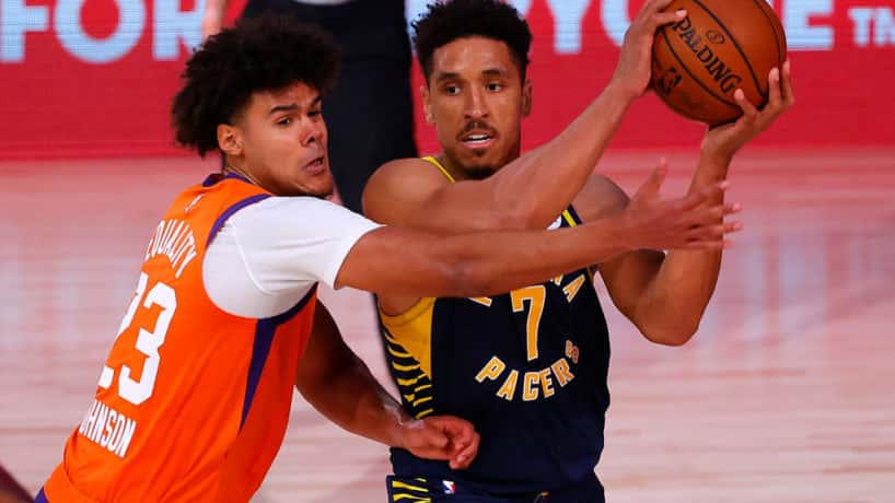 Pacers guard Malcolm Brogdon tries to pass against the Suns.