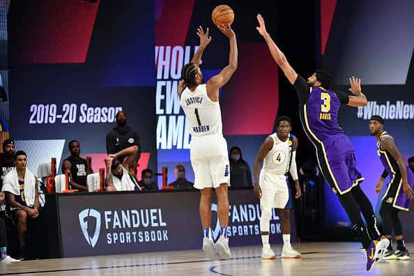Pacers forward T.J. Warren shoots over the Lakers.