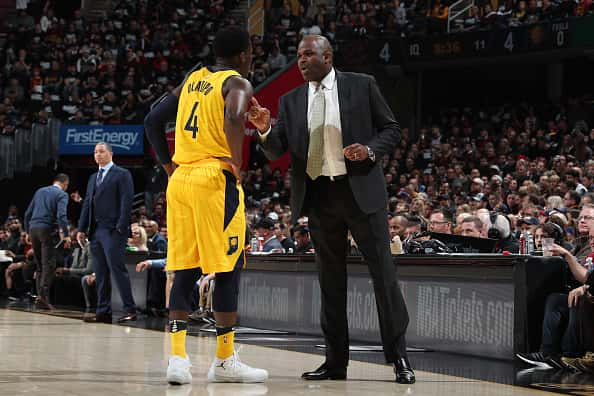 Pacers coach Nate McMillan talks to Victor Oladipo during a game.