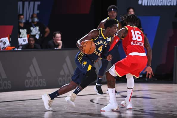 Pacers Victor Oladipo tries to drive against the Rockets.