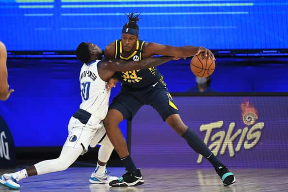 Pacers center Myles Turner backs down the Mavericks in the bubble.