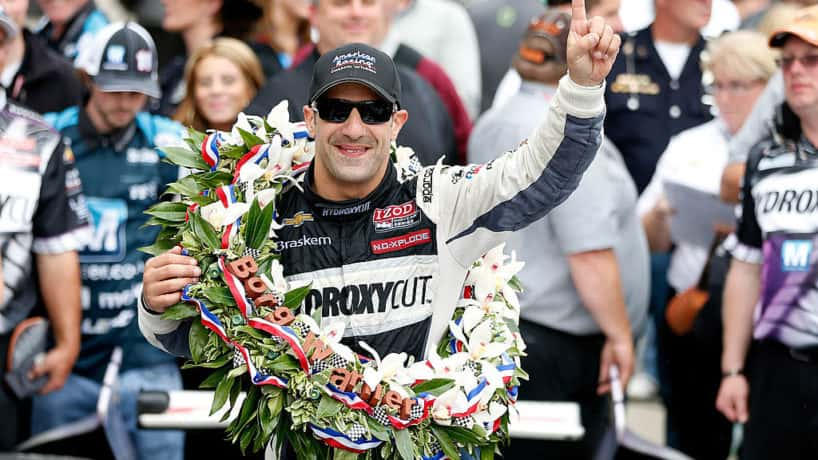 Tony Kanaan of Brazil, driver of the Hydroxycut KV Racing Technology-SH Racing Chevrolet, celebrates in victory circle during the IZOD IndyCar Series 97th running of the Indianpolis 500 mile race at the Indianapolis Motor Speedway on May 26, 2013 in Indianapolis, Indiana.