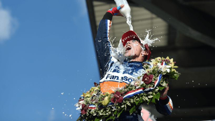 Takuma Sato celebrating
