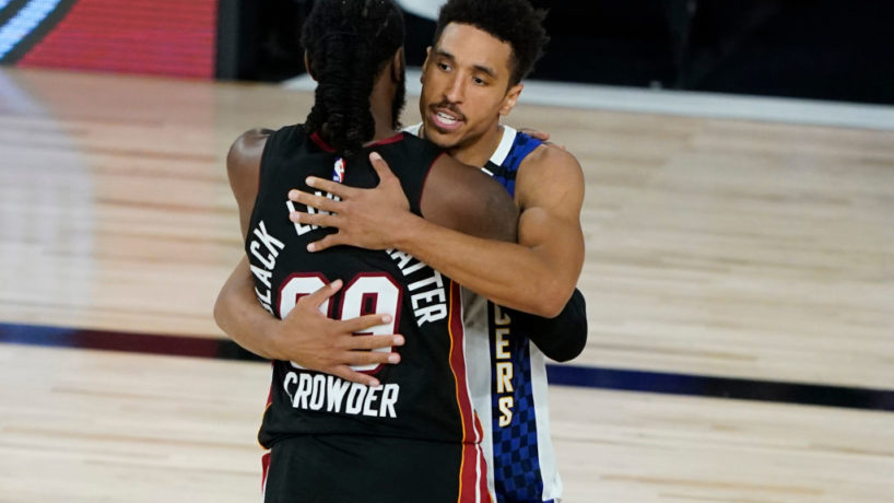Pacers guard Malcolm Brogdon hugs Heat forward Jae Crowder.