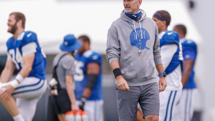 Colts head coach Frank Reich walks around the practice field.