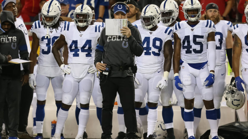 Indianapolis Colts defensive coordinator Matt Eberflus looks to his play sheet while making a call in the second quarter of an NFL matchup between the Indianapolis Colts and Kansas City Chiefs on October 6, 2019 at Arrowhead Stadium in Kansas City, MO