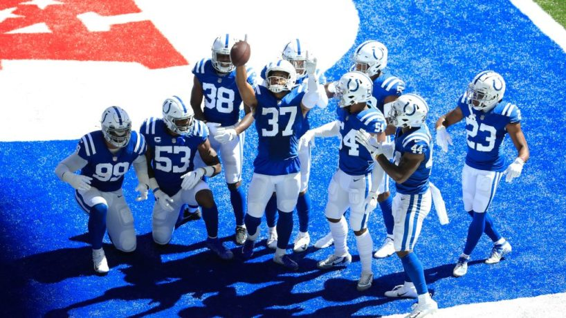 Colts defenders celebrate an INT.