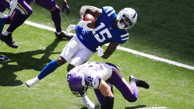 Colts wideout Parris Campbell gets hit by Vikings safety Harrison Smith.