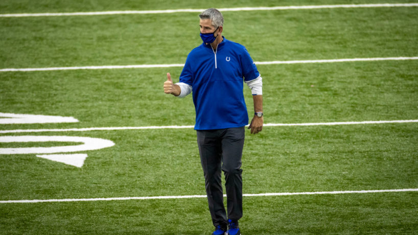 Colts head coach Frank Reich offers a thumbs up walking off the field.