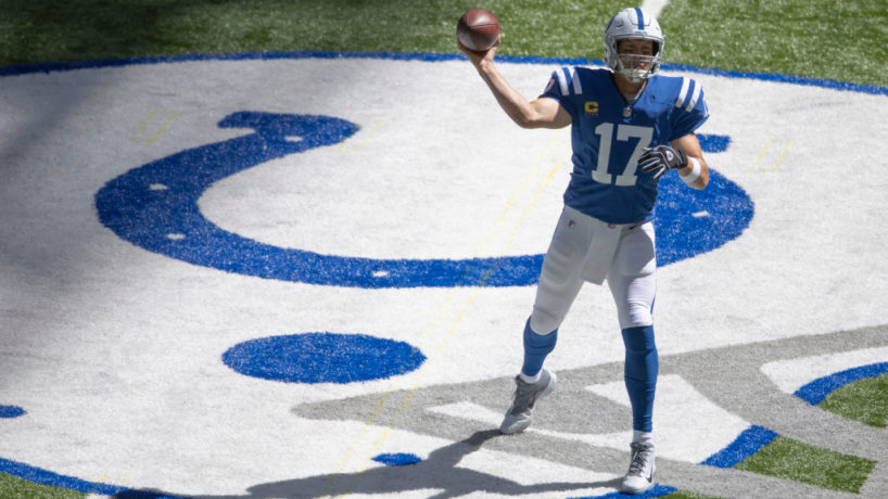 Colts quarterback Philip Rivers throws a pass at Lucas Oil Stadium.