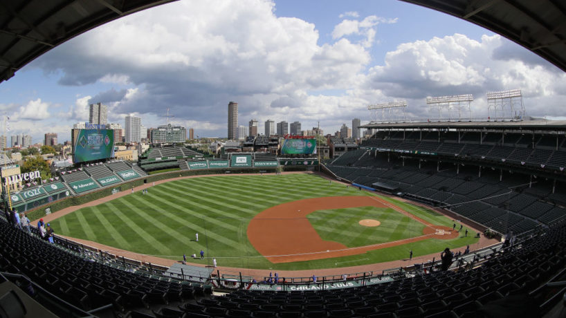 An empty Wrigley Field with cloud coverage above prepares to host Game 1 of the NL Wild Card Series between the Cubs and Marlins