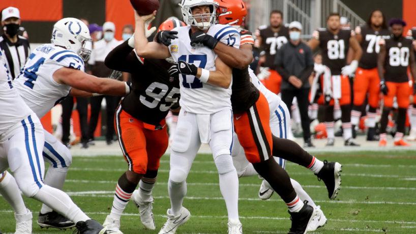 Colts QB Philip Rivers throws under pressure.