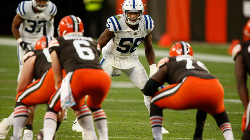 Colts linebacker Bobby Okereke looks towards Browns quarterback Baker Mayfield under center behind his offensive line